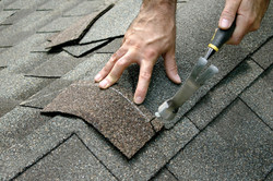 carpenter nailing a broken roof ametex roofing waco texas