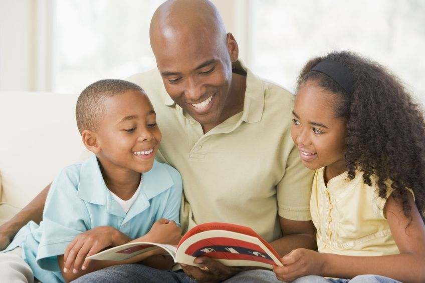 father-and-children-reading