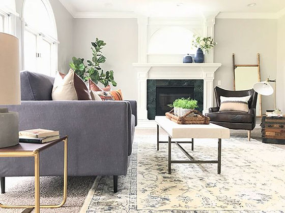 Home Staging - Staged living room with couch and large fireplace