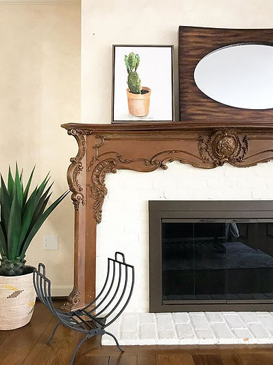 Staging details around a beautiful fireplace