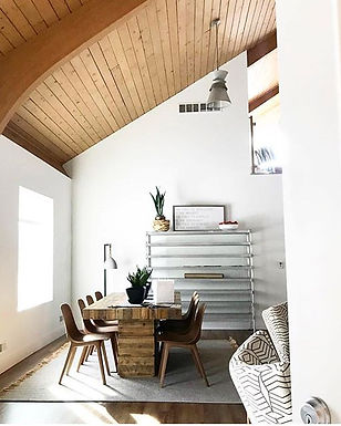 wood ceilings, ikea, cork chair, reclaimed wood table, white walls, high ceilings, mid cntury modern, industrial shelves, snak plant, concrete lamp, inteior design, inerior decor, rug, fringe, modern decor, interior styling, s+e designs