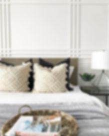 s+e designs, bedroom, bedroom design, pillows, pillow design, geometric pillow, geometric wall, plaid wall, board and batten, woven tray, white andbright white walls, wite bedrom, geometric lamp