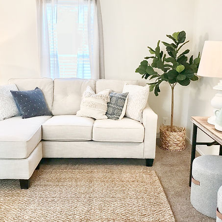 fiddle leaf fig, fiddle fig, jute rug, sisal rug, pillow covers, tan couch, chaise sectional, pouf ottomans, pouf ottomans leather handles, fringe pillow, living room design, s+e designs
