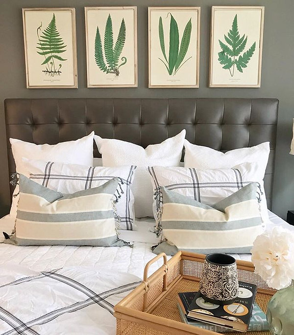 Bedroom staging with pillows and wall art