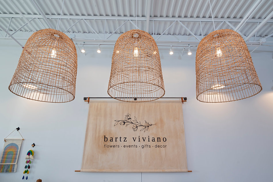 wicker pendants, rattan pendants, canvas boutique sign, canvas lathe sign, cavas sign, white walls, bartz viviano, s+e designs, s and e designs