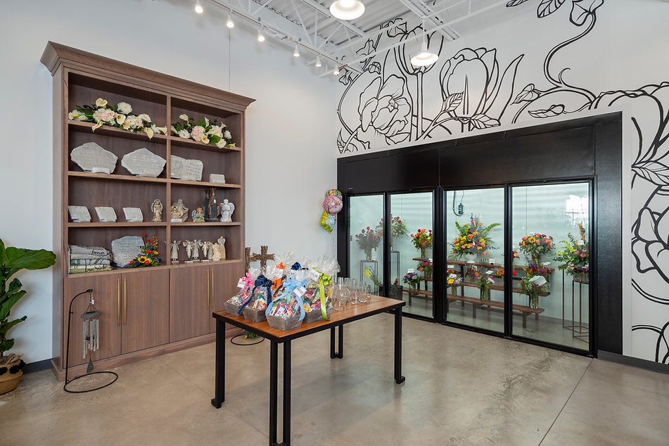 vorst custom cabinets, concrete floors, boutique style, boutique design, tiered shelf, store displays, bartz viviano, s+e designs, mural, black and white flower mural, cnsultation room, plant display, plant wall, northwest ohio floral, flower shop, waterville ohio