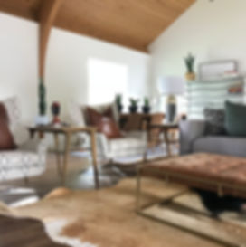 church to home, leather ottoman, wood ceilings, cement lamp, mid century modern, cowhide rug, tongue and groove ceilings, s+e designs, white walls, beams, exposed beams, wood ceilings, interior design