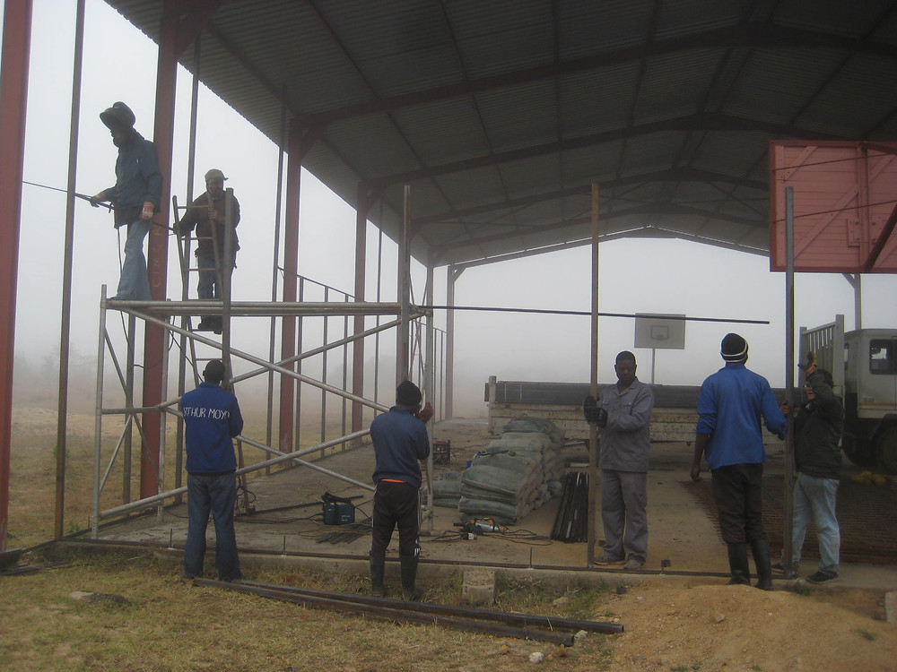 Razi and the team welding the metal framework in place