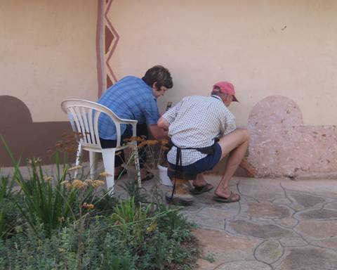 Rentia and Chris busy repainting walls on one of the camp chalets