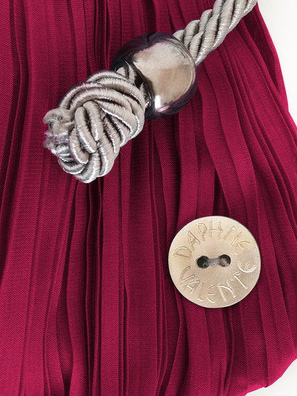 Burgundy Penelope pouch button detail.jpg