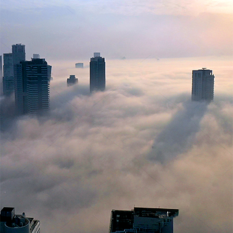 Tel Aviv real estate building wit fog