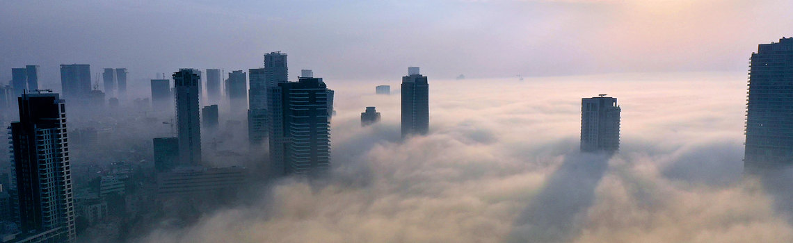 Fog and clouds over Tel Aviv and commercial real estate skyscrapers in Israel