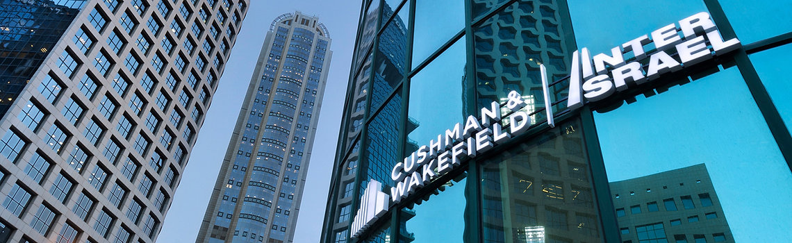 Cushman and Wakefield Inter Israel logo sign on front of the company's building