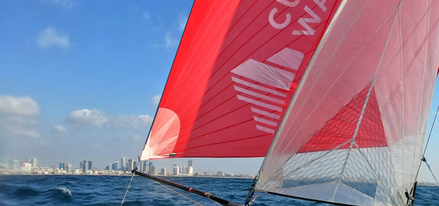 Cushman and Wakefield Inter Israel logo on a sail with Tel Aviv skyscrapers on the edge of the horizon