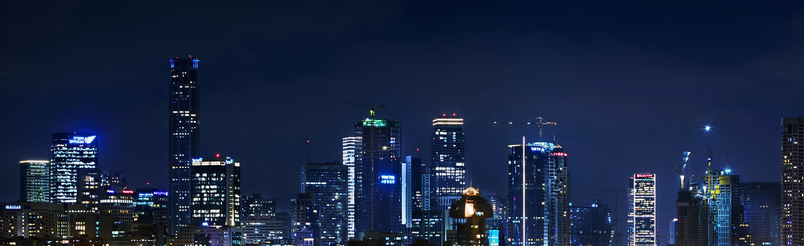 Tel Aviv skyline at night with skyscrapers
