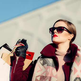 Woman consuming fashion holding shopping bags looking to the future