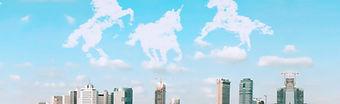 Tel Aviv skyline with unicorn clouds