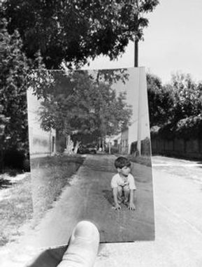 Psychotherapy | Image of Man Holding Photo of childhood