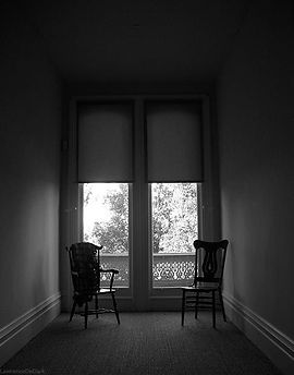 Beginning Psychotherapy | Image of two chairs by a window
