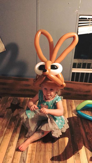Balloon animal hat I made for River