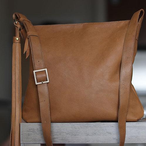 Soho. Tan patina leather crossbody bag