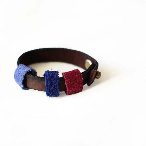 Genuine nubuck bracelet with suede rings on it