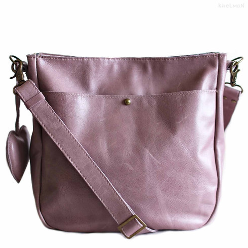 the front pocket of Ulrica Lavender purple crossbody leather bag by Khelman