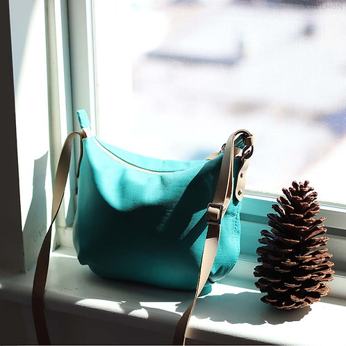 Borla. Turquoise teal crossbody bag