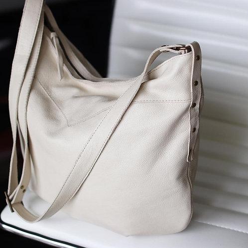 Custom Demilune in warm brown leather