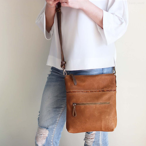 Somerset. Double sided leather crossbody bag