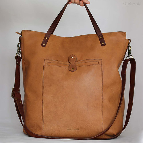 The bag has a long leather cross body strap