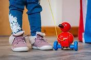 child-with-wooden-duck (1).jpg
