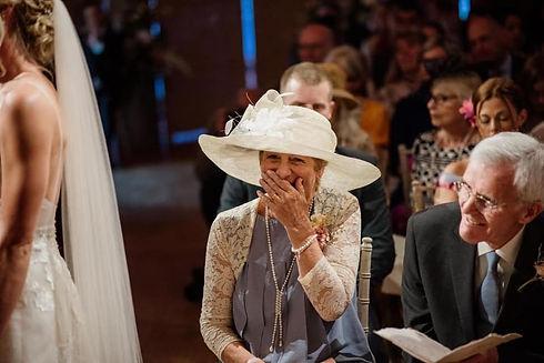 Lady wearing large hat at wedding
