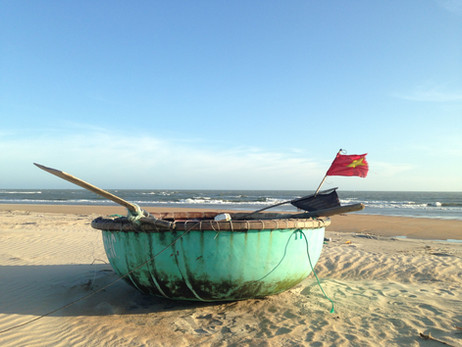Fishing boats and beach running in Vietnam
