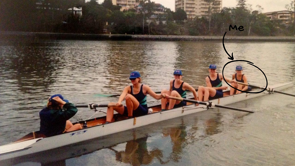Claire McFarlane in a row boat at the bow