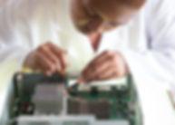 crop-focused-repairman-fixing-graphics-c