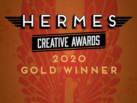Michaelis, Montanari & Johnson Wins Gold Hermes Award for Logo Design