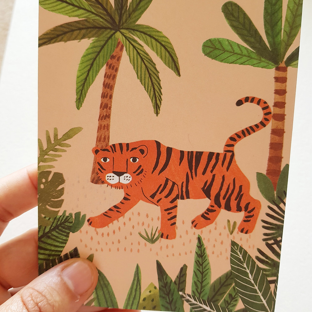 גלויית ההשראה שלנו. תמונה של נמר בג'ונגל