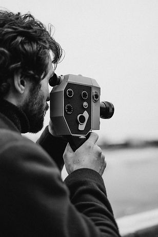 man-in-long-sleeve-capturing-photo-36926