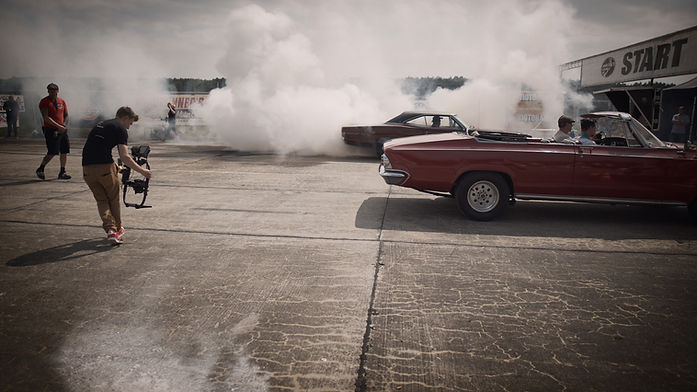 car-covered-with-smoke-on-pavement-11076