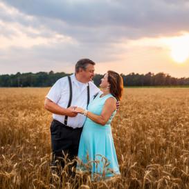 Couple in Golden Wheat Fields