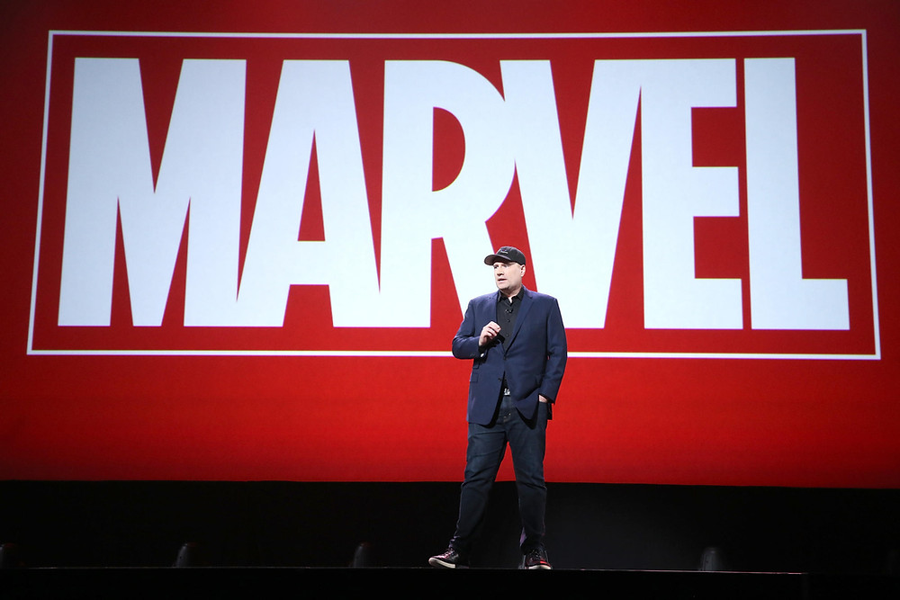 This year marks the 10th anniversary of Marvel Studios. Here, Marvel Studios President Kevin Feige presents at the 2015 D23 Expo in California. JESSE GRANT / GETTY IMAGES FOR DISNEY