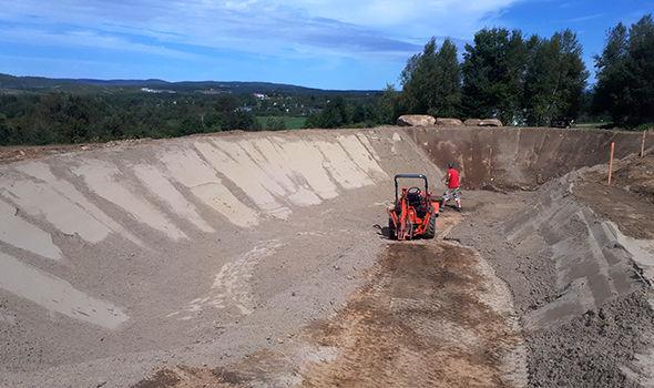 Aménagement fond de sable lac artificiel