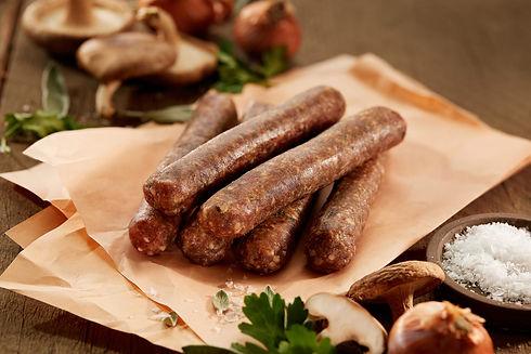 Saucisses d'agneau échalotes et vin blanc