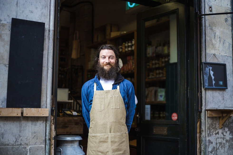 cheerful-store-owner-with-an-apron-pictu