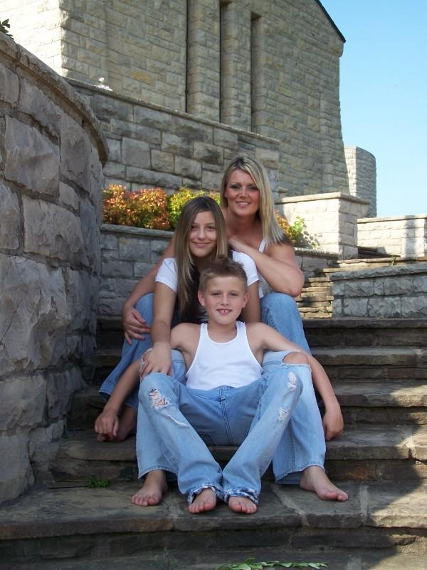 Single mom with kids on steps.jpg