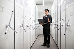 bank-manager-using-notebook-in-a-locker-