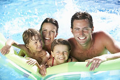 Family On Holiday In Swimming Pool.jpg