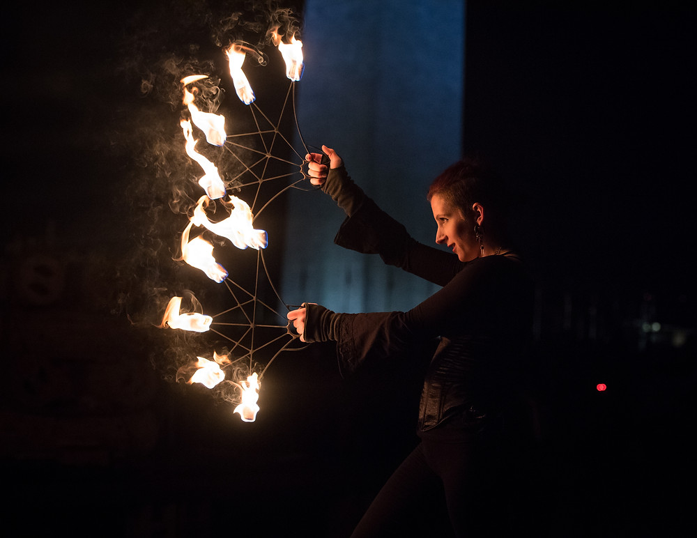 A fire spinner performs just prior to the ceremonial burn at Catharsis on the Mall: A Vigil for Healing, Saturday, November 11, 2017 in Washington DC.
