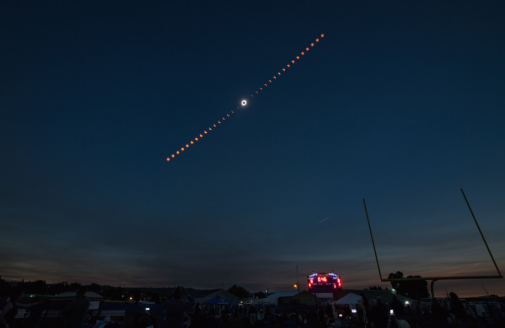 This composite image shows the progression of a total solar eclipse over Madras, Oregon on Monday, August 21, 2017.
